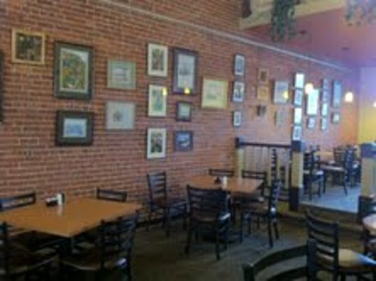 Boston Bean Cafe : Casual seating with local artwork displayed on original brick wall