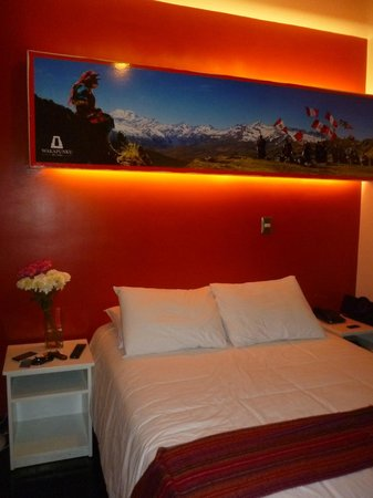 Wakapunku Hotel Boutique : las camas y decoración