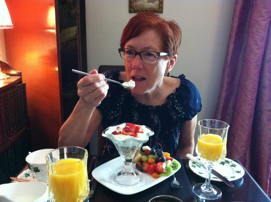 The Town House B&B Guest House: My wife enjoying 'Elaine's fruit sundae', for breakfast.