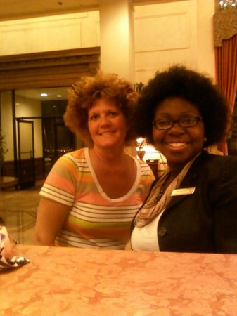 Millennium Hotel Durham: Jamie front desk clerk and I . I did my hair like hers then we disco danced in the lobby.