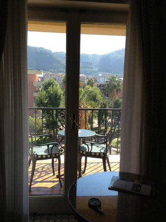 Grand Hotel Royal: View of balcony...no sea views available, but it is across a park and nursery with mountains.