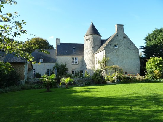 Le Manoir de Juganville : Back of the home from sitting are in the yard