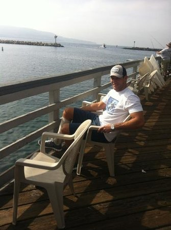 Pollys On The Pier: relaxing outside waiting for our table