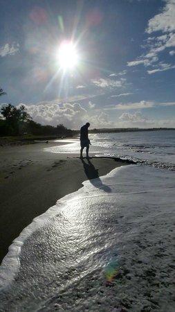 Waimea Plantation Cottages: Hubby walking on beach at sunrise