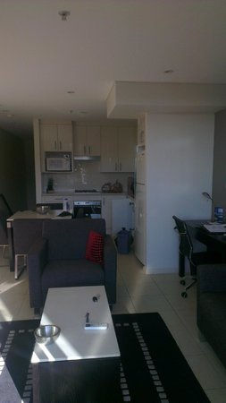 Meriton Serviced Apartments George Street, Parramatta: kitchen and lounge room