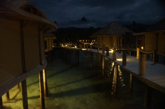 "Coconuts Beach Club : Night time on the walk way in between the Over the water Fala""s"