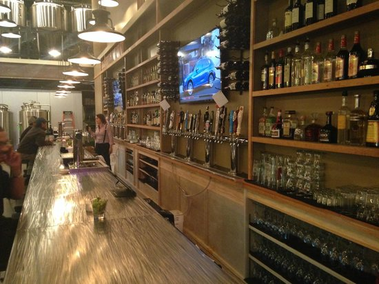 Skewed Brewing: 46' Stainless steel bar with 48 beer draft lines, and 8 wine draft lines