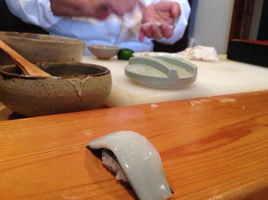 Wasabi: Chef preparing ika nigiri right on the spot