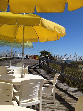 Ocean Grill & Tiki Bar : Searing on the back deck looking at the Tiki Bar. Great view and location!