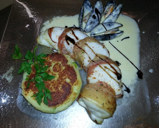 The Bayview Bar : Prime Fillet of Monkfish wrapped in Parma Ham served on a Spring Onion Potato Cake with a Mussel