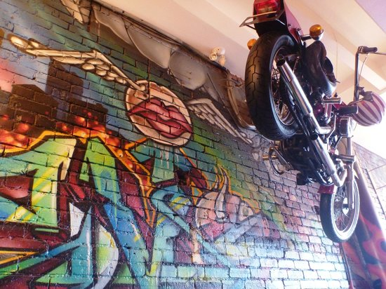 Restaurant L'Avenue: wall art and a hanging motorcycle