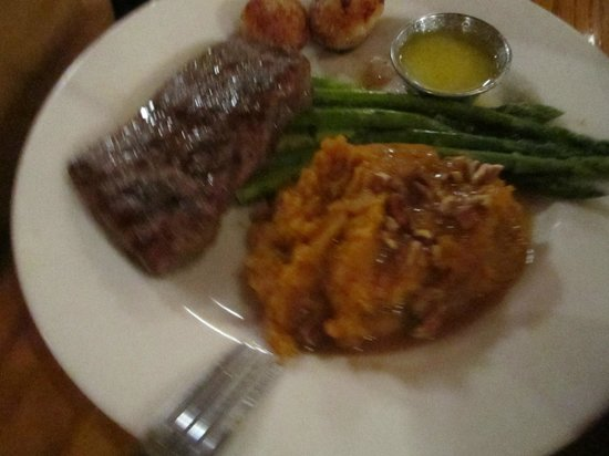 Rockfish Seafood Grill: Steak and scallops with mashed sweet potatoes and asparagus.