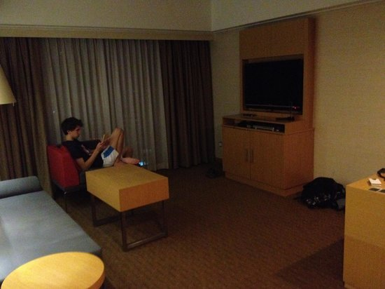 Novotel Singapore Clarke Quay: Living room with sofa that can be pulled out & made into a bed & LCD TV with various cable adapt