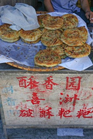 "Xizhou Town: The best ""Baba"" (a pancake, or Chinese pizza dough) in town, it's located in town square"