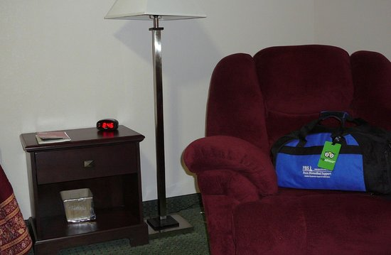 Millstream Inn : Nightstand, single pole lamp & comfy chair