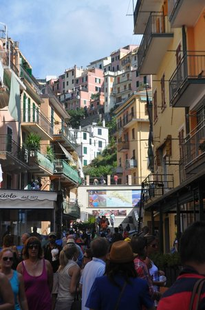 La Scogliera: The main street of Manarola - busy in late September.
