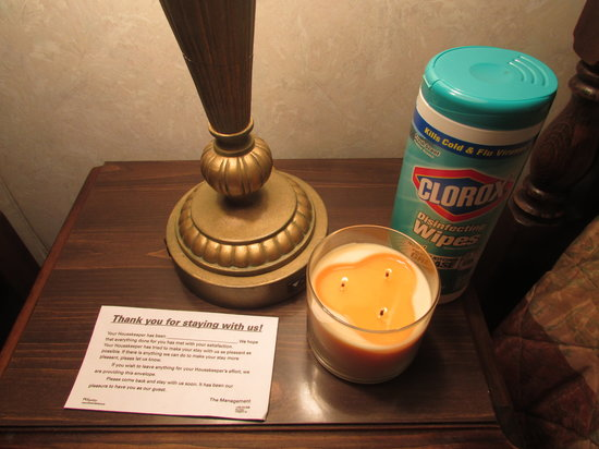 Cherry Lane Motor Inn: My Clorox wipes, the candle (to try to change the smell) and the management note ...notice no na