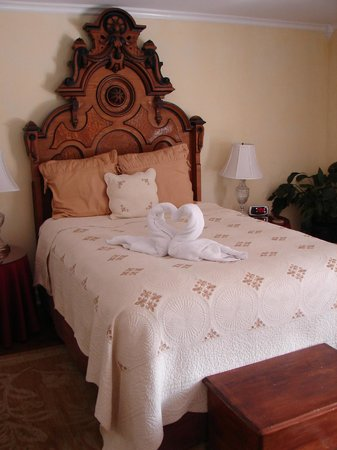 The Brentwood B&B: Our lovely antique bed with swan towels