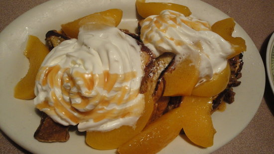 "Cobblestone Cafe: ""The Harvest"" special... french toast, peaches, eggs, sausage"
