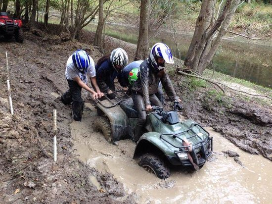 Carolinabackwoods Atv Tours Getting Busy Digging Her Quad Out Of The Mud With Sister