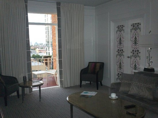 Top of the Park Restaurant: living room with french doors to balcony