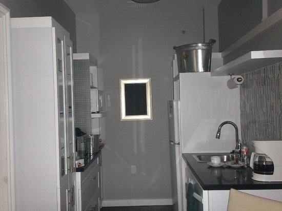 Top of the Park Restaurant: kitchen with stove, microwave and supplies
