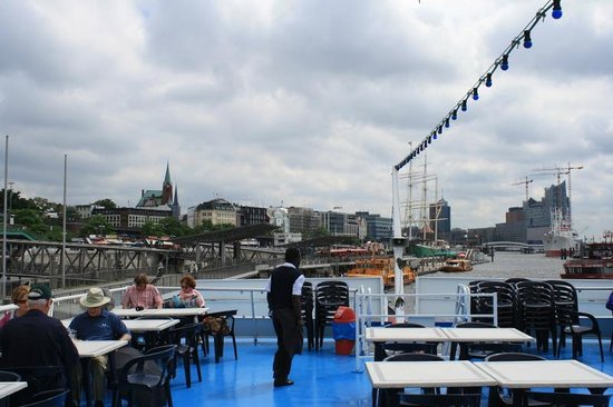 Rainer Abicht Cruise: Open topped boat with tables on the top deck