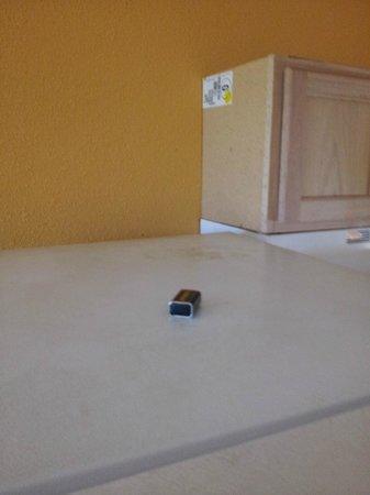 Days Inn Port Aransas TX: battery on fridge and packing label on cainet in room 210