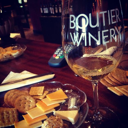 """Cracker and cheese plate and souvenir """"Boutier Winery"""" glass filled with a delicious sample of w"""