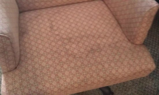 Comfort Inn & Suites : Unknown stain on room chair