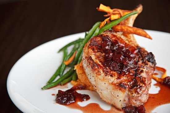 Roca Restaurant & Bar: Double Cut Pork Chop with whiskey Cherry Sauce