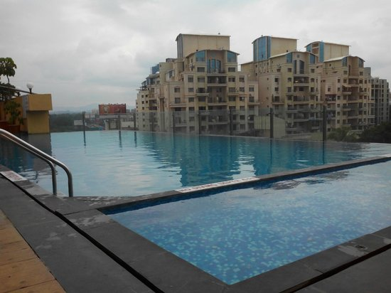 Royal Orchid Central Pune: Outside res. complex viewed alongside the pool