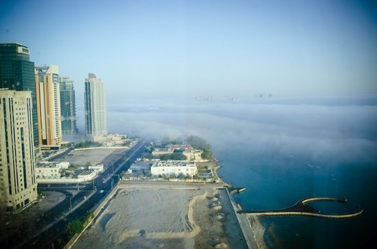 Hilton Doha: view from our window. had to experience first hand of foggy morning in Doha. Winter is almost he