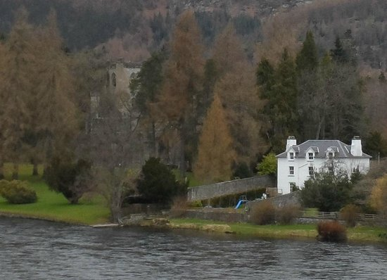 View of Dunkeld Cathedral, peeping through trees.