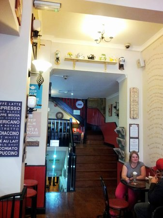 Coffee Continental: Ground floor archway leading to rear section with coffee grinder decor