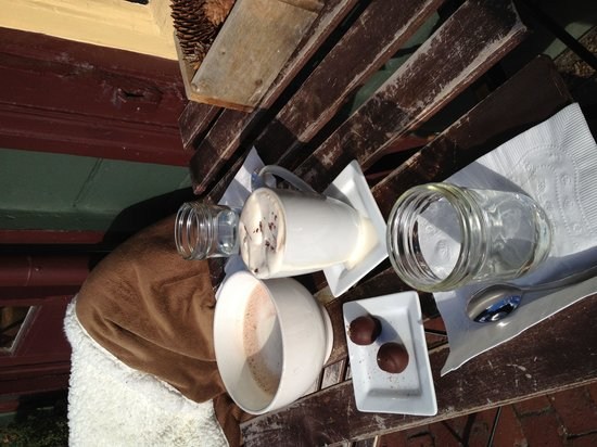La Maison De Coco: outside with coffee