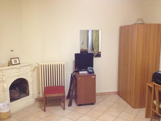 Hotel Colomba : Armoire with safe, room refrigerator and fireplace.  furnished simply but amply