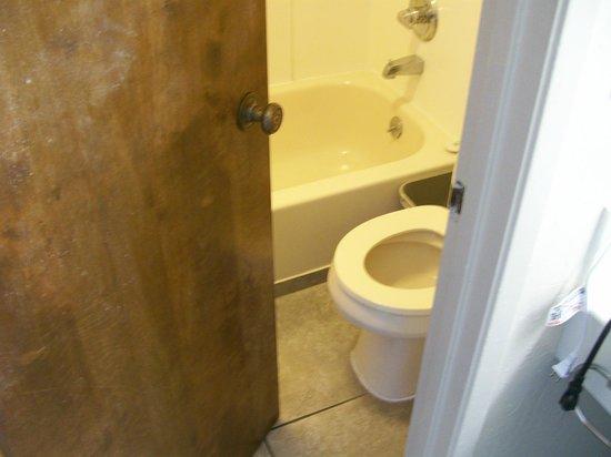 knee knocker doors on the bathroom picture of torch lite inn