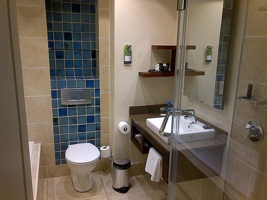 Bathroom with separate shower and bath  Picture of Southern Sun Elangeni &am # Sun Shower Spa_161739