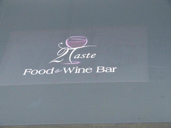 2 Taste Food and Wine Bar: Logo above rear entrance
