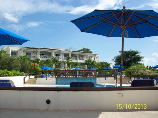Beach View: pool area with one of the apartment complex' in the background