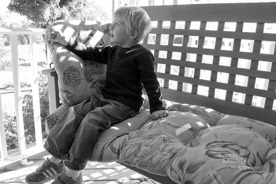 Inn At The Ridge: A little visitor enjoying the swing on the front porch.