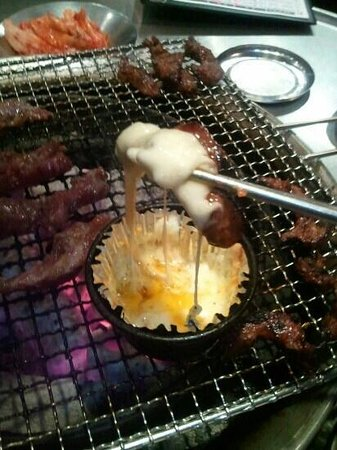 Sinpo Choigozip Gwangmyeong Cheolsan: melted cheese with meat.