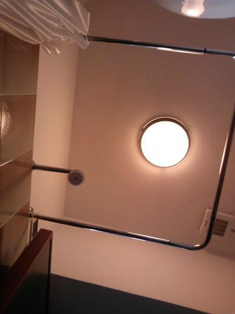 Roma Hotel : looking straight up in the bathroom (the shower curtain rod is about the same size as the room)