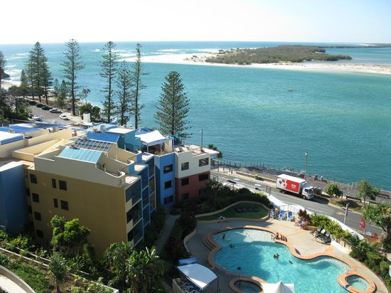 Breakfree Grand Pacific Resort Sunshine Coast: View from the balcony down to the resort pool and over to Bribie