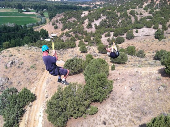 Ririe, ID: Bro in law, and his brother going down the tandem zip