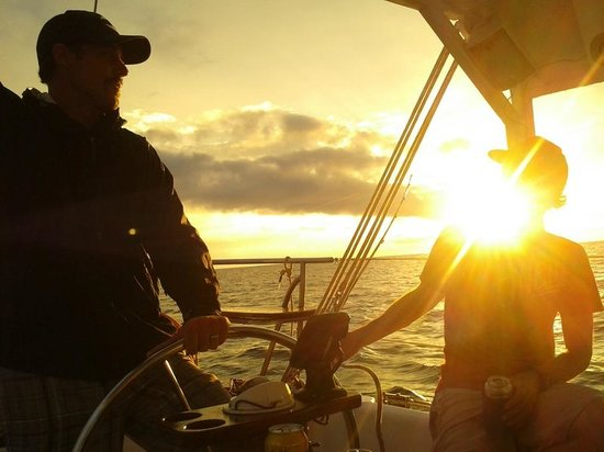 Sailing Conchal Day Tours: Enjoying the sunset while sailing with Capt. Brad.