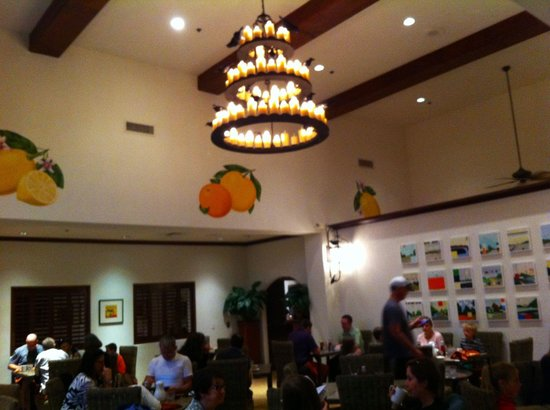 Tangerine Grill: Crows decorate the chandelier for Halloween