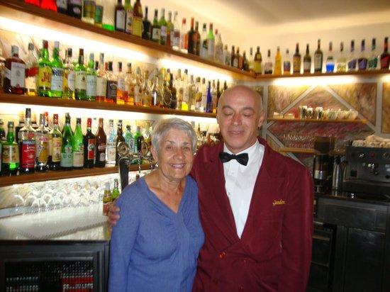 Hotel Garden: Waiter Antonio with bar in background