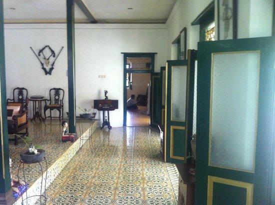 nDalem Gamelan Hotel : the formal sitting area .
